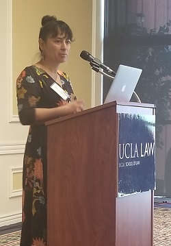 Alumna Claudia Peña '08, co-founder and co-director of Repair, speaks at the Student Leadership Breakfast.