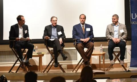 """Adam Sullins '99, Steve Greenberg '77, Jeffrey Moorad and Ahmad Nassar discuss integrity in sports gambling at """"All Bets Are On"""" on Feb. 8."""