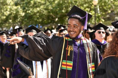 UCLA Law J.D. class president Curtis Harris '19, leads the procession of graduates at the school's 68th commencement ceremony.